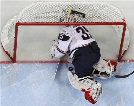 Goalkeeper Howard of the U.S. fails to save a puck during their 2012 IIHF men's ice hockey World Championship game with Slovakia in Helsinki